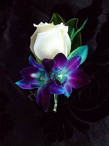 No peacock feather in this boutonniere but the purple blue ...