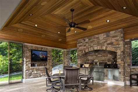 covered patio with fireplace and grill