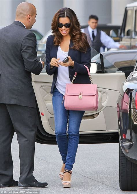 Eva Longoria turns heads... this time in super skinny jeans as she visits her agent after her ...