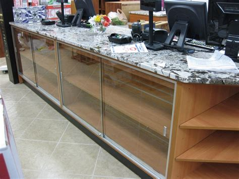 custom checkout counter with granite top liquor store