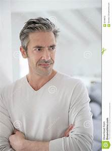Handsome Middle-aged Man Standing At Home Stock Photo ...