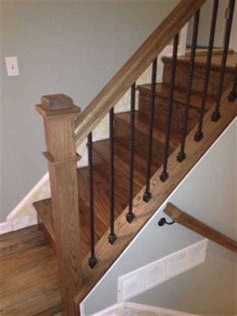 replacing stair spindles custom fabricated wrought iron spindles with stained rail 1881