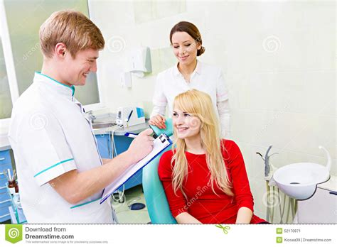 patient in dentist office answering doctor