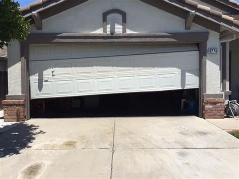 garage door sticking before garage door stuck half way open due to broken