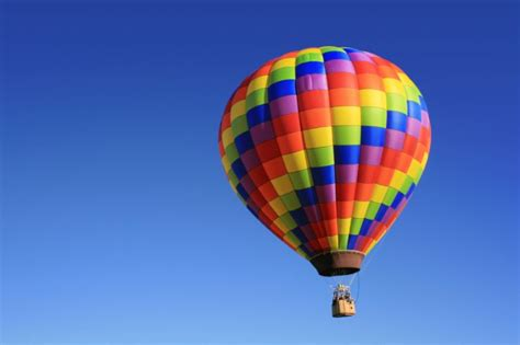 A man flying in a hot air balloon suddenly realizes he's ...