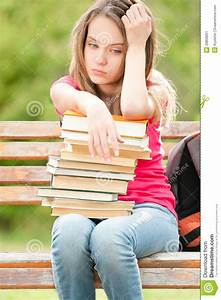 Beautiful And Sad Young Student Girl Sitting On Bench With ...