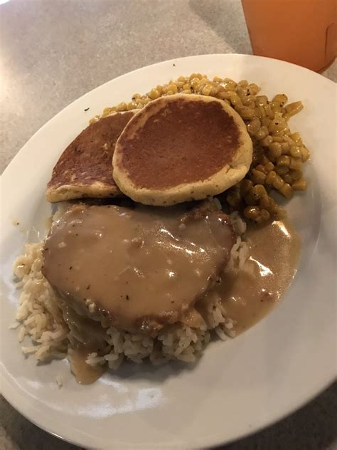 In a bowl, stir together corn meal, flour, sugar, baking soda, salt and brown sugar. Smothered pork chop with rice and gravy, fried corn, and ...