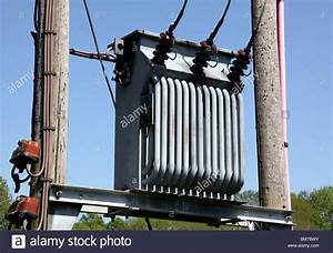 3 Phase electricity transformer mounted between 2 utility ...