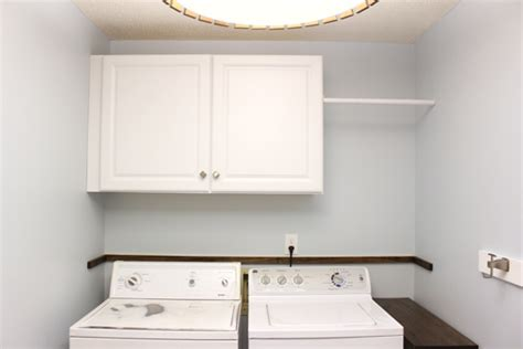 cabinets over washer and dryer installing wall cabinets in laundry checking in with chelsea