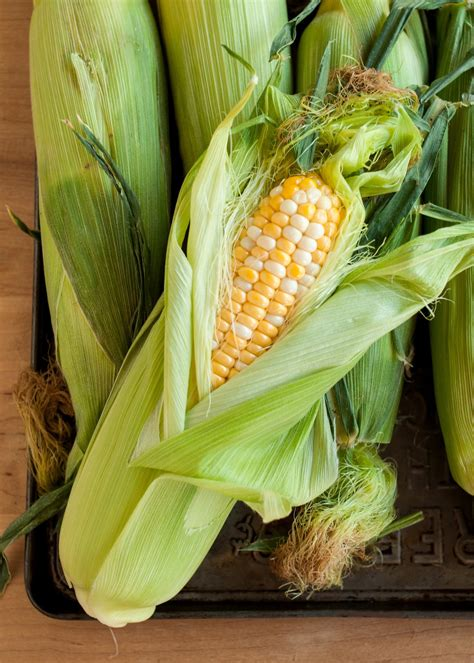 boil corn in husk how to cook corn on the cob in the microwave cooking lessons from the kitchn the kitchn