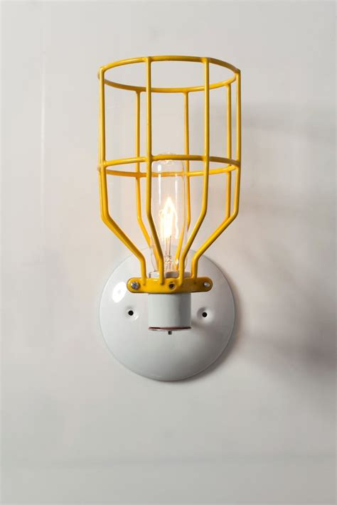industrial wall sconce yellow wire cage wall light