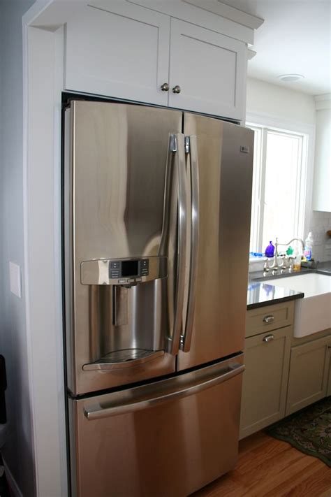 stainless steel apron sink white cabinets traditional new england kitchen featuring shaker style