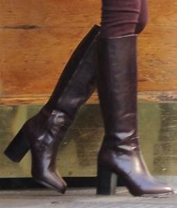 Taylor Swift Shows Off Fall Style in Burgundy Leather Boots