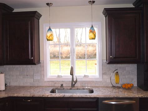 pendant lights sink traditional kitchen