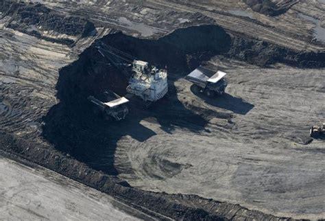 albertas oilsands boom opened doors  temporary