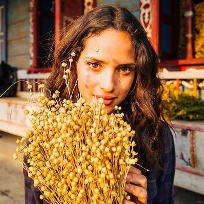 Adria Emerald Arjona Dorothy Sweet Holding Flowers