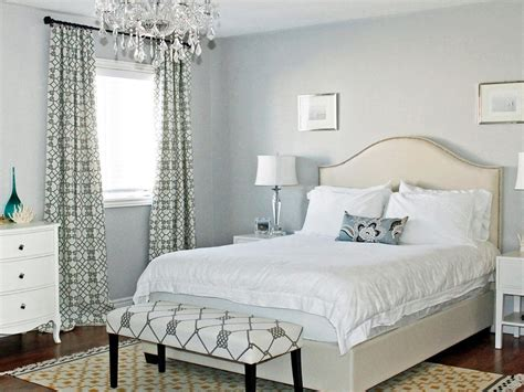 Light And Airy Neutral Bedroom With Crystal Chandelier