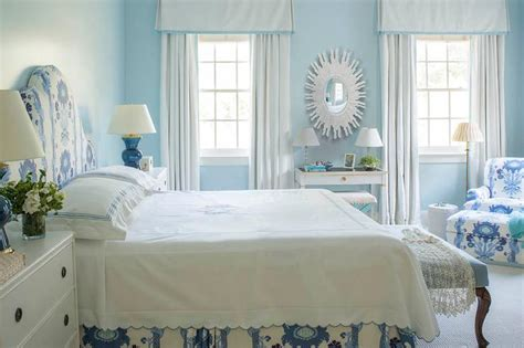 white and blue bedroom with gray desk and white