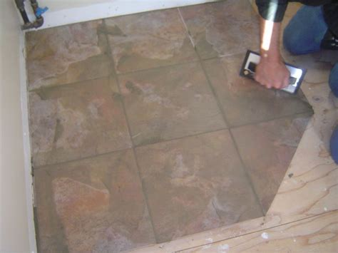 applying grout to ceramic tile floor