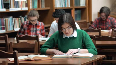 University students study quietly in library - Free Stock Video