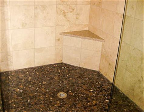 granite shower seat with travertine tile