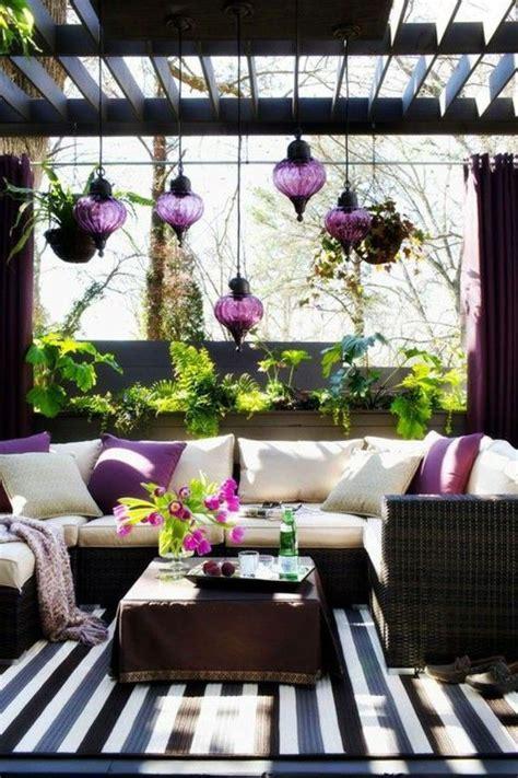 wood glass light plant covered patio modern patio decor