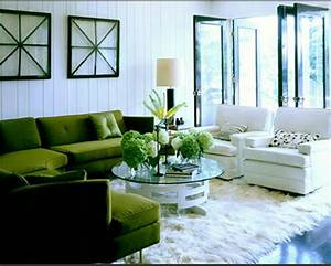 Feather and nest adding a zing of colour for White and green living room