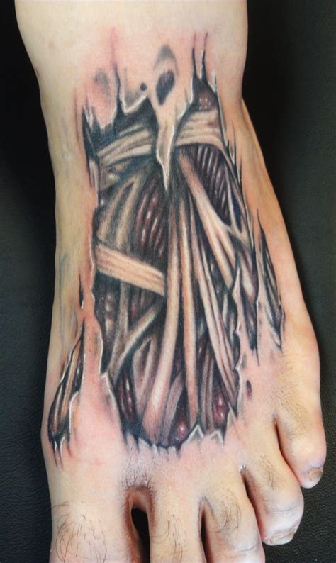 bones  tendons skin rip foot tattoo headless hands