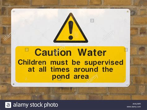 Safety Warning Sign To Show Children Must Be Supervised Near A Pond Stock Photo, Royalty Free