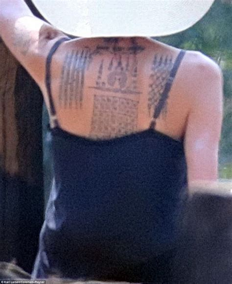 angelina jolie debuts  tattoos  directs khmer rouge