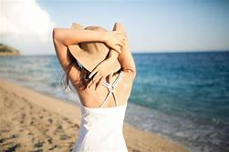 Image result for a girl enjoying beach sun