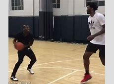 Paul Pogba shows off his basketball against Joel Embiid
