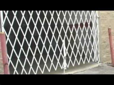 Accordion Style Scissor Gates 888 270 3636   YouTube