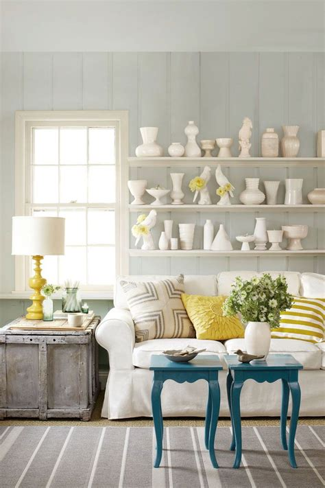 A blank wall is like a blank canvas—it's filled with possibilities. 10 Ways to Decorate That Big Blank Wall You're Trying to Avoid   Big blank wall, Living room ...