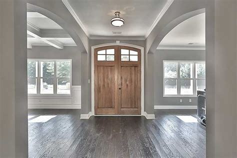 floor l in front of window plan 36061dk bright and airy craftsman house plan coffer white trim and moldings