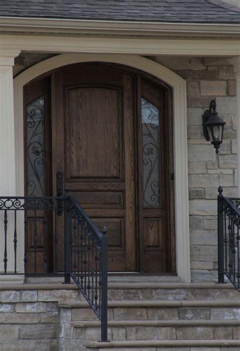 solid wood front door  accent side panels windows