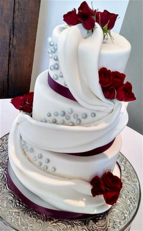 wedding cake drapes wedding cake with drapes in 3 tiers with fresh roses jpg