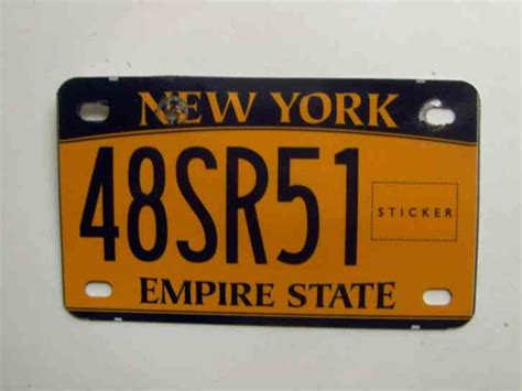 New York Motorcycle License Plate, Damaged Has Hole On