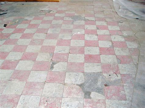 damaged asbestos floor tile   square