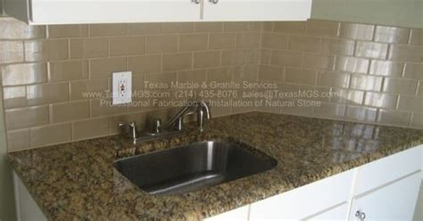 exle of new venetian gold granite in white kitchen with