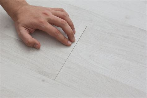 how to fix gap between how to fix laminate flooring gaps howtospecialist how