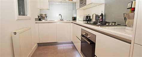 white l shaped kitchen with island g shaped kitchens