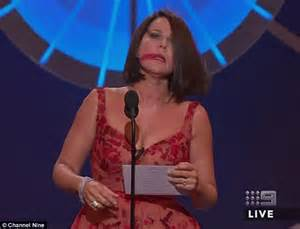 australian actress julia morris logies 2016 sees julia morris trips on stage while