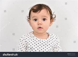 Portrait Of A Cute Baby Girl With Beautiful Big Brown Eyes ...
