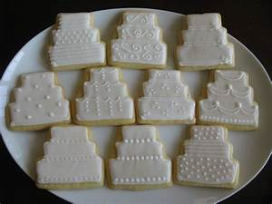 wedding cake cookies on plate lindsay39s bridal shower With wedding cake cookie favors