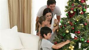 Footage In High Definition Of Family Decorating A ...