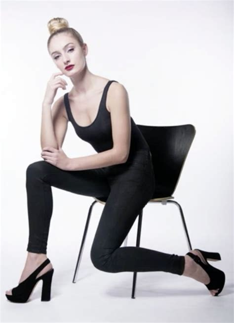 Sitting Chairs by Model Sitting On Chair In Fashionable Pose Show