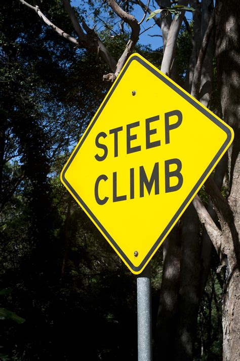 Free Stock Photo 10769 Yellow Steep Climb Sign With Metal