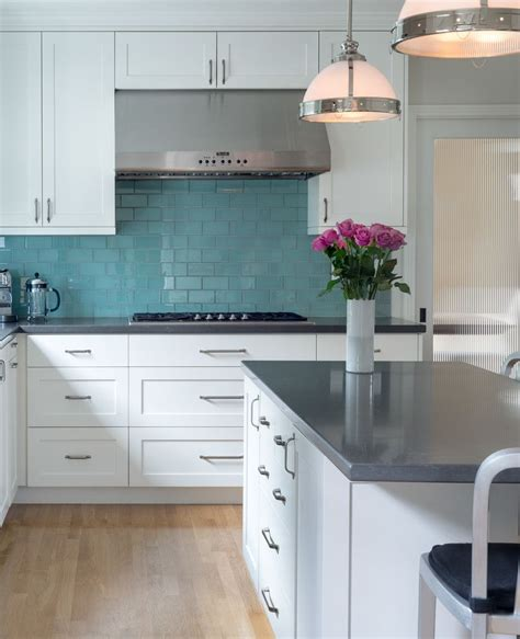 kitchen  white cabinets gray countertops turquoise