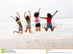Beach jump stock photo. Image of friendship, four, happy ...